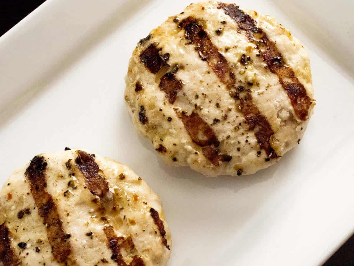 Two grilled turkey burgers on a plate