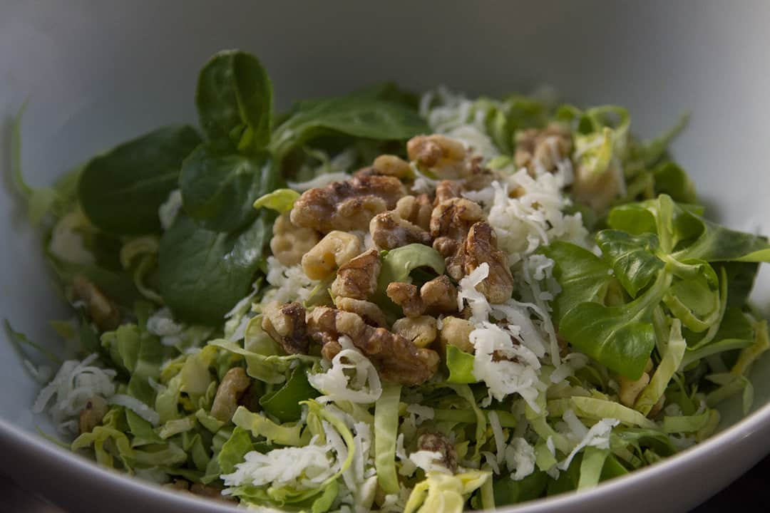 Brussels sprouts salad with mache, walnuts, Iberico cheese and tarragon vinaigrette