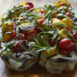 Eggplant sandwich topped fresh tomatoes, basil and balsamic reduction.