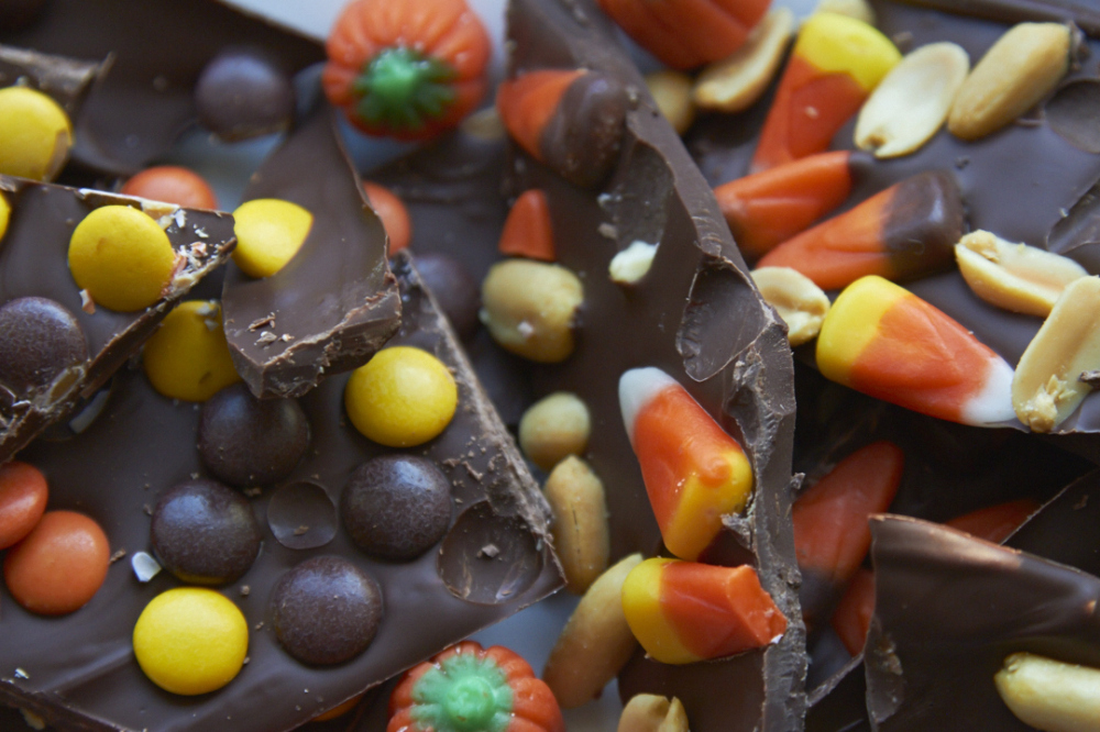 Chocolate bark with candy corn, peanuts, and Reeses pieces