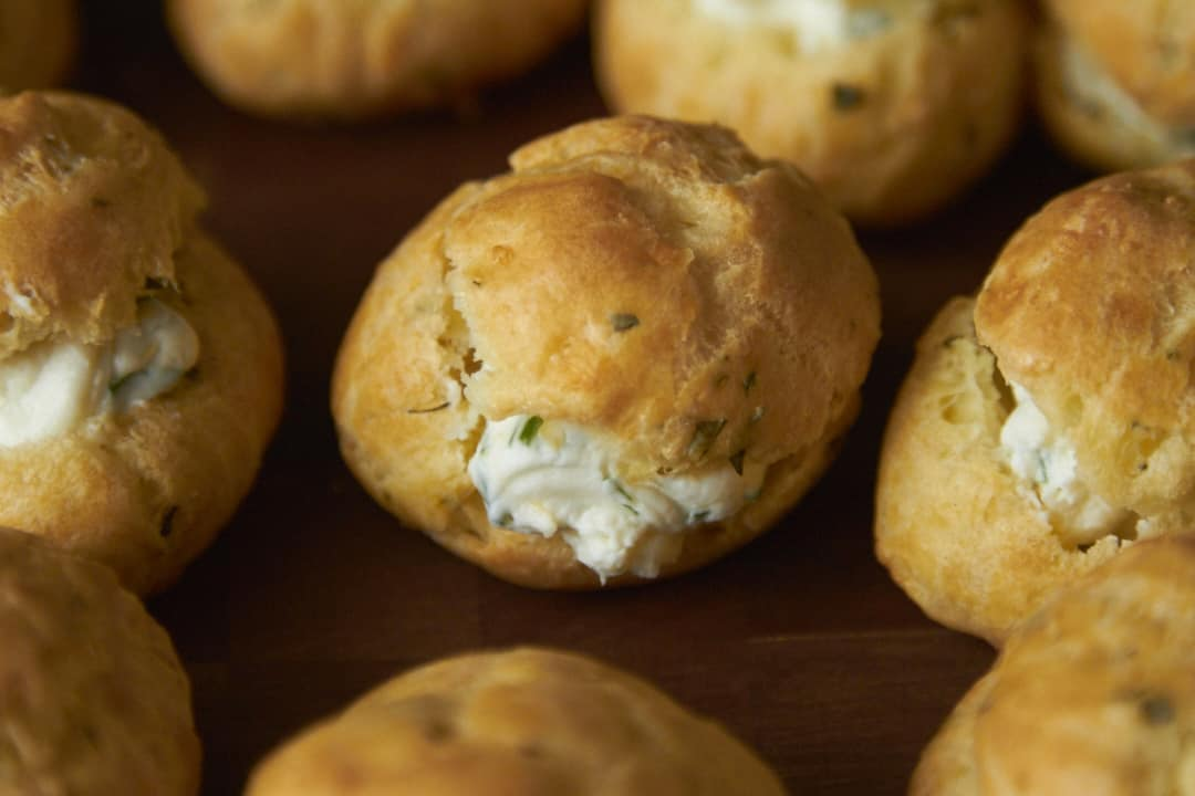 A parmesan-rosemary gougère with goat cheese filling.