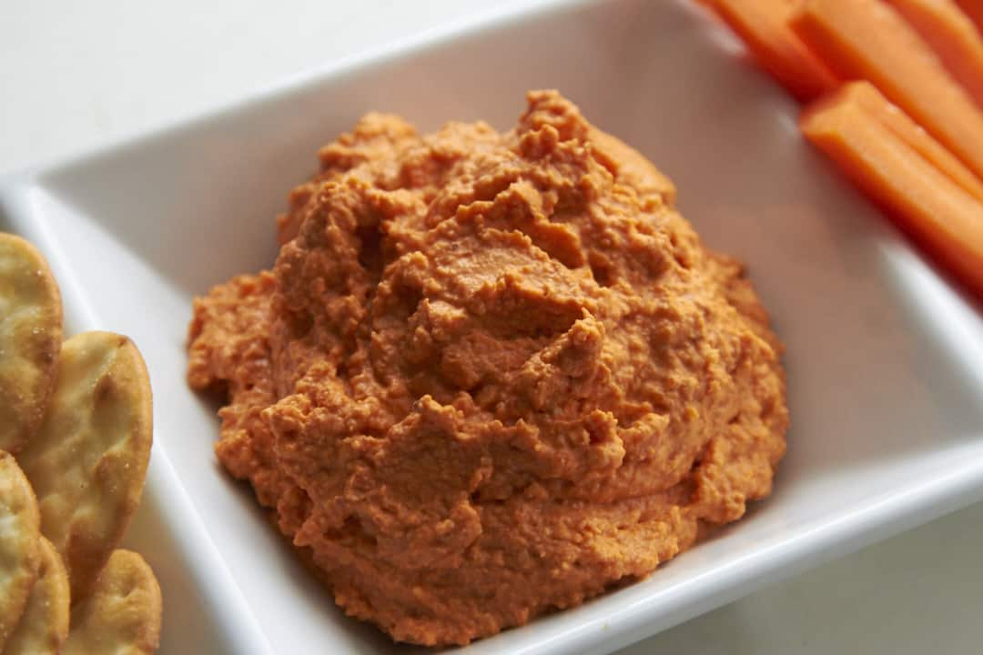 A bowl of creamy romesco dip.