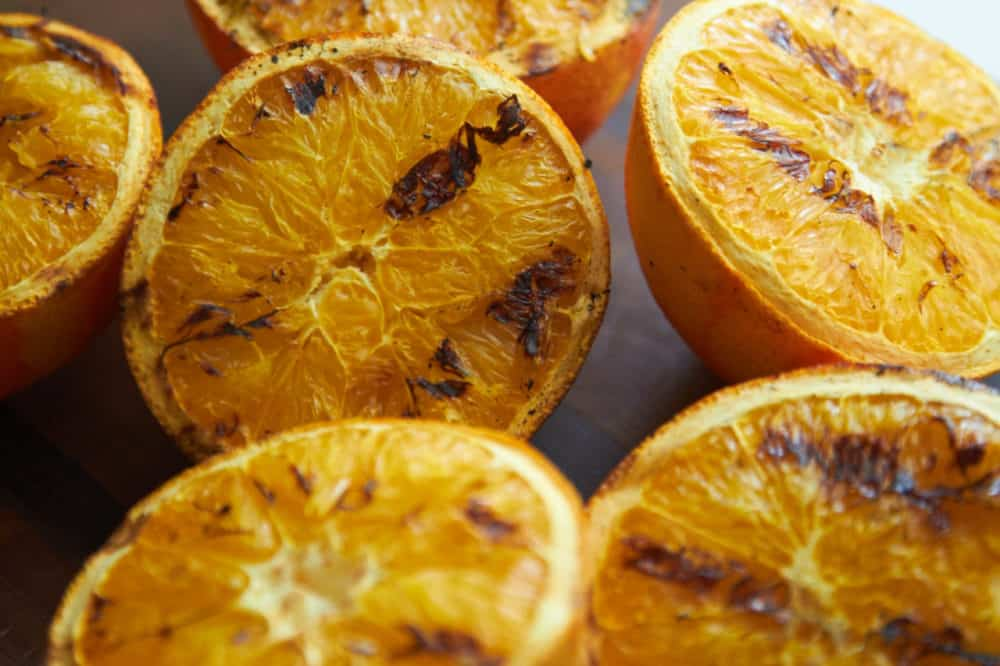 Grilled orange halves.