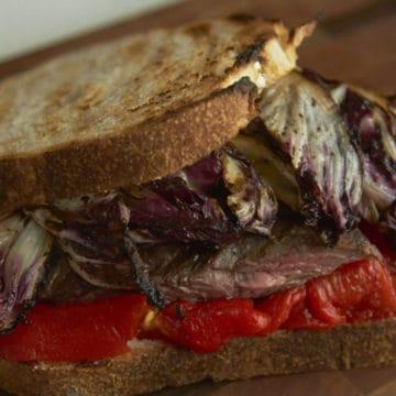 Italian steak sandwich on toasted bread.