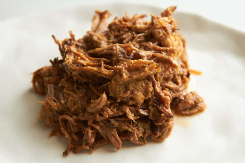 Cooked pulled pork on a plate