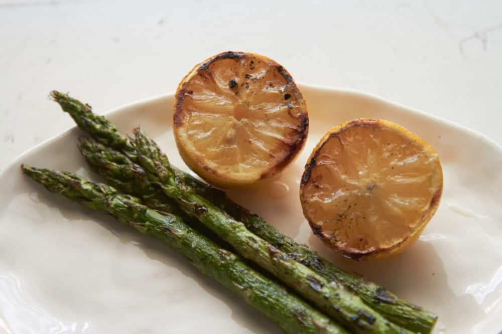 Grilled asparagus and lemon halves