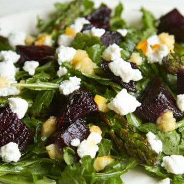Roasted vegetable salad with charred lemon vinaigrette includes grilled beets and asparagus, and goat cheese.