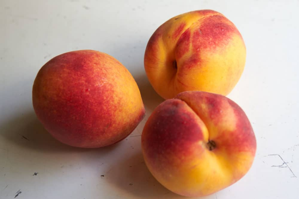 Three whole peaches