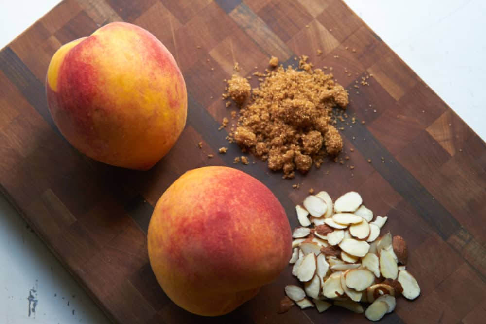 Ingredients for peach crisp - peaches, almonds, brown sugar