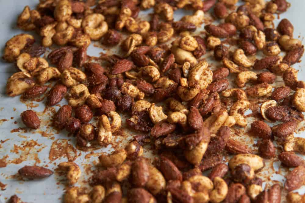 Spiced nuts on parchment paper.