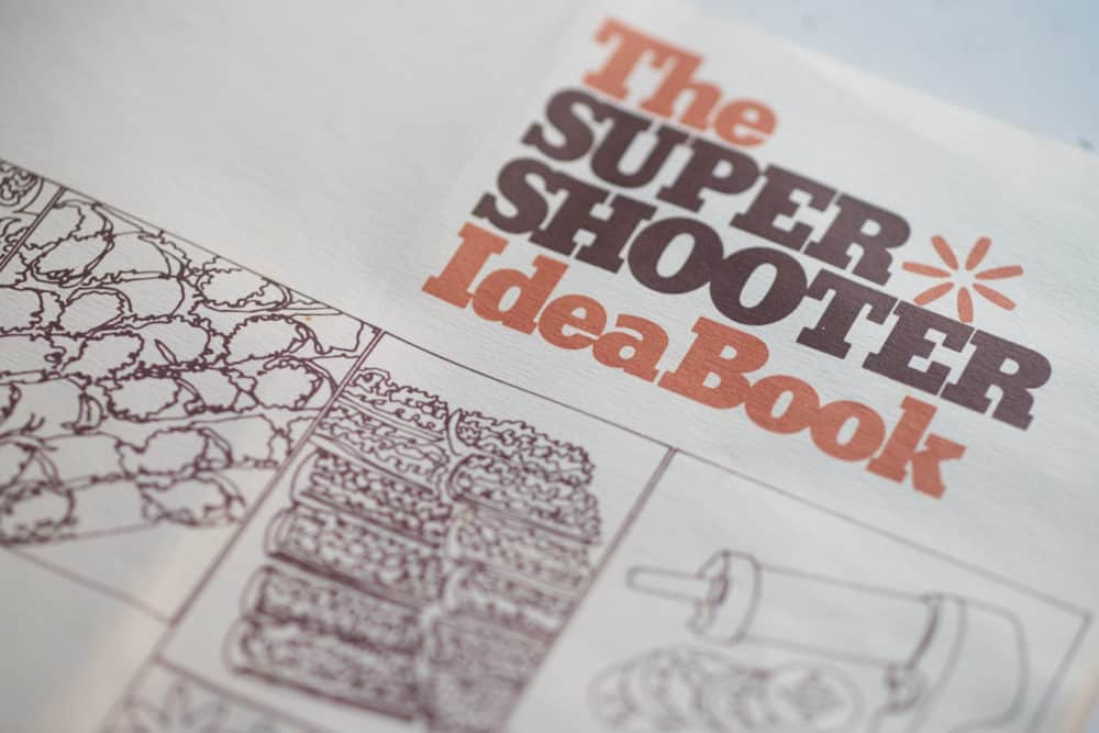 "A recipe book entitled, ""The Super Shooter Idea Book"" featuring simple drawings of the kitchen tool and the food that can be made with it."