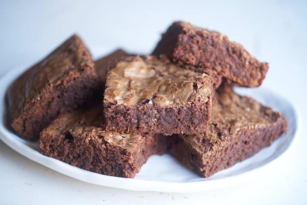 A plate of gooey dark chocolate brownies.