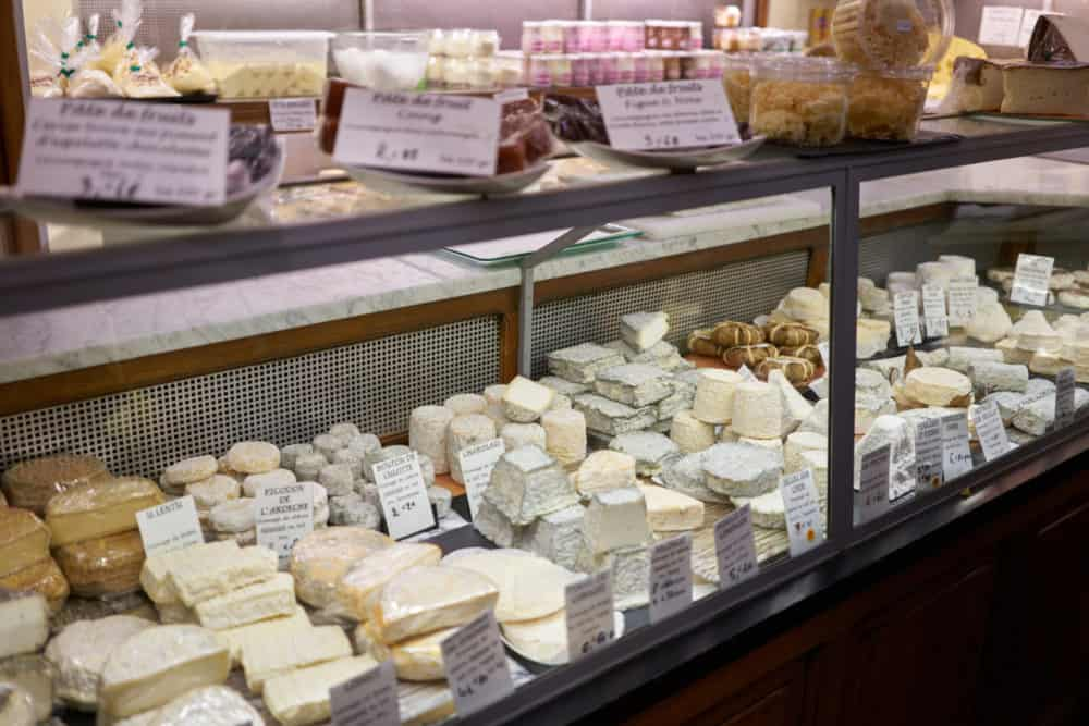 French cheeses in a refrigerated case at Fromagerie Jouannault in the Marais neighborhood of Paris.