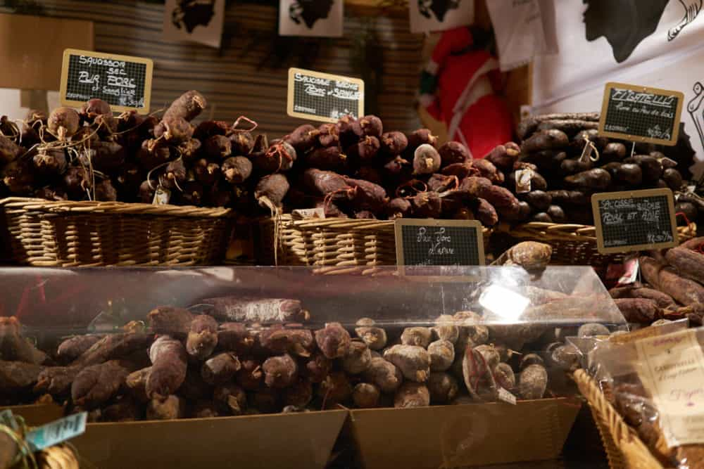 Baskets of local charcuterie for sale at the Christmas market in Reims, France.
