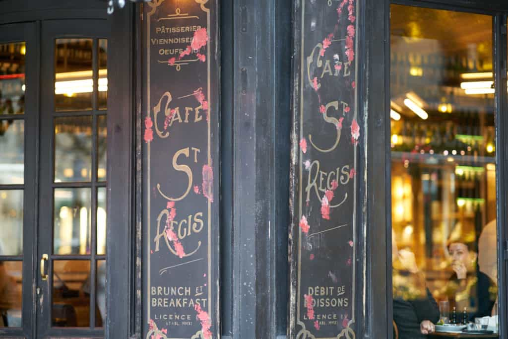 The front doors and windows of Café St. Regis in Paris.