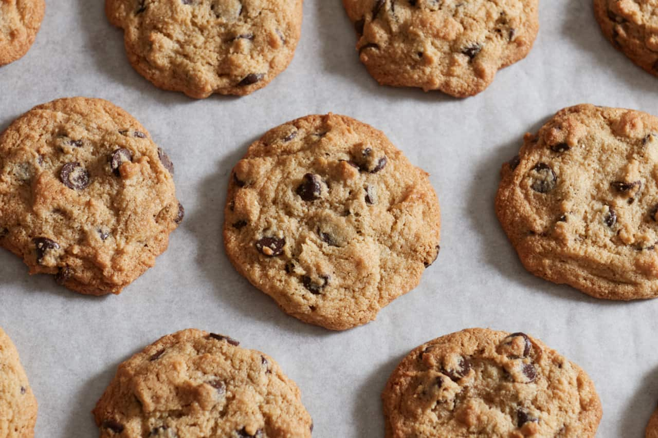 Gluten free chocolate chip cookies on parchment paper.