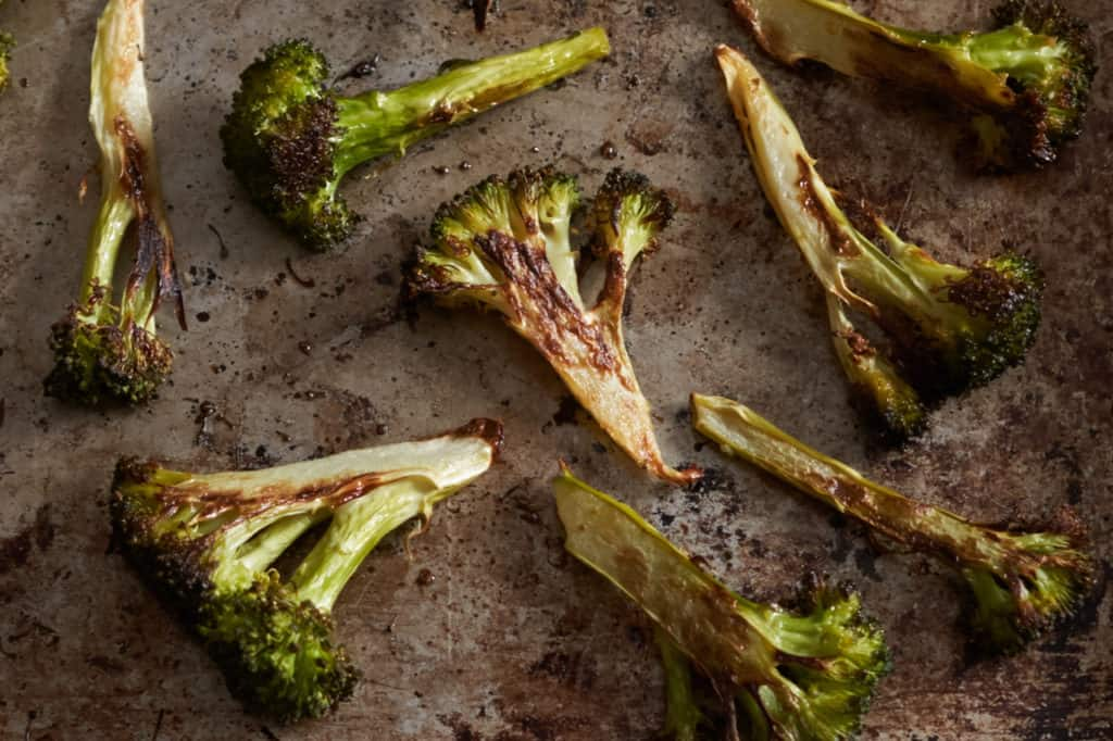 Charred broccoli on a sheet pan.