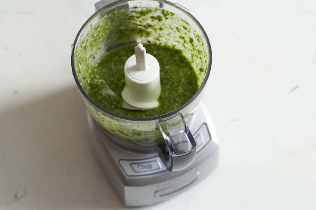 A small food processor with chile lime cilantro sauce.