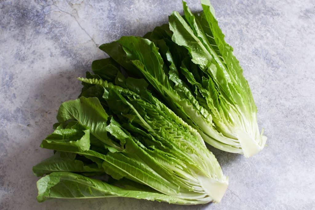 Romaine lettuce cut in half.