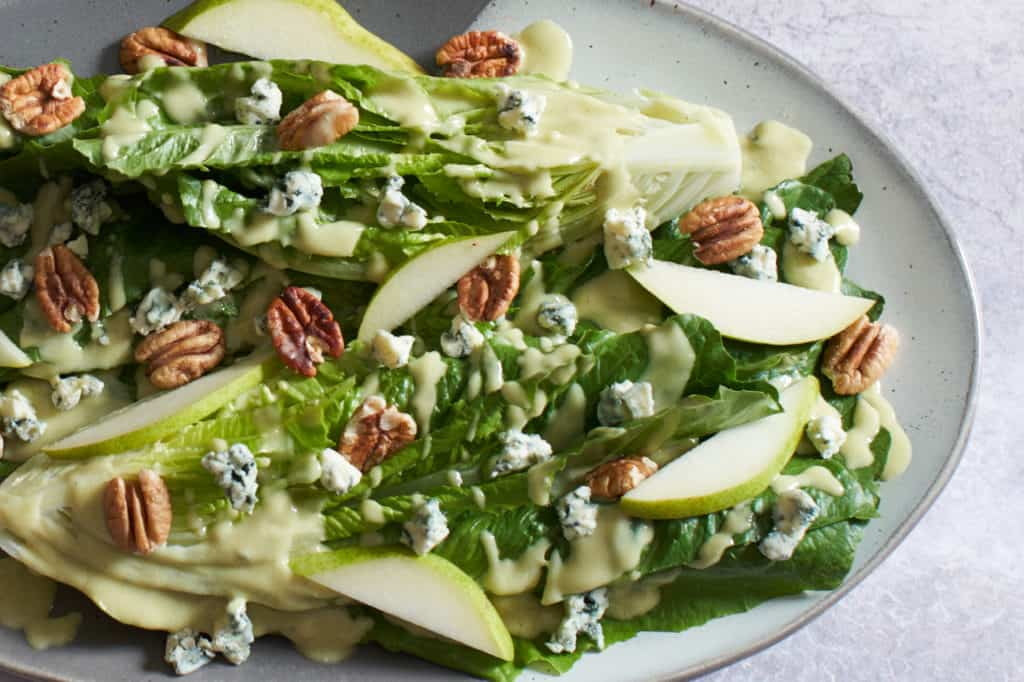 Romaine Hearts salad with blue cheese, pears, and pecans.