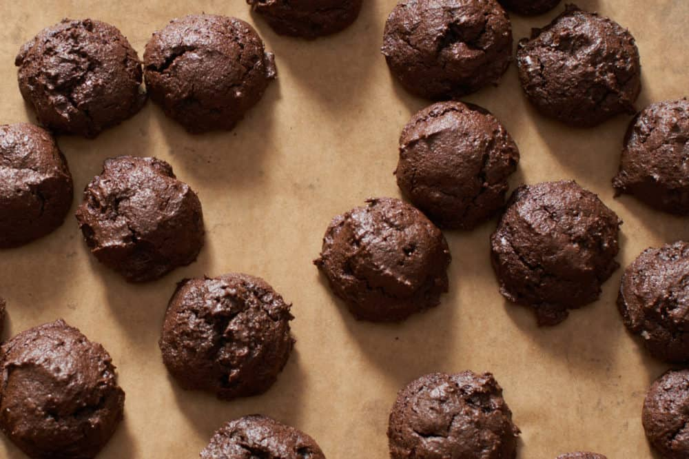 Gluten free triple chocolate cookies on a baking sheet.