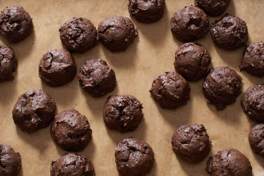 Gluten free triple chocolate cookies on a baking sheet.