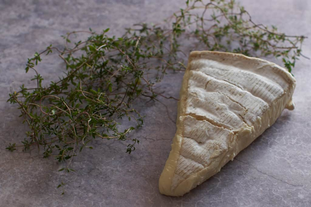 Fresh thyme and a wedge of brie