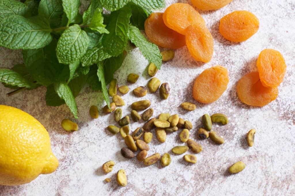 Fresh mint, dried apricots, a lemon and some pistachios
