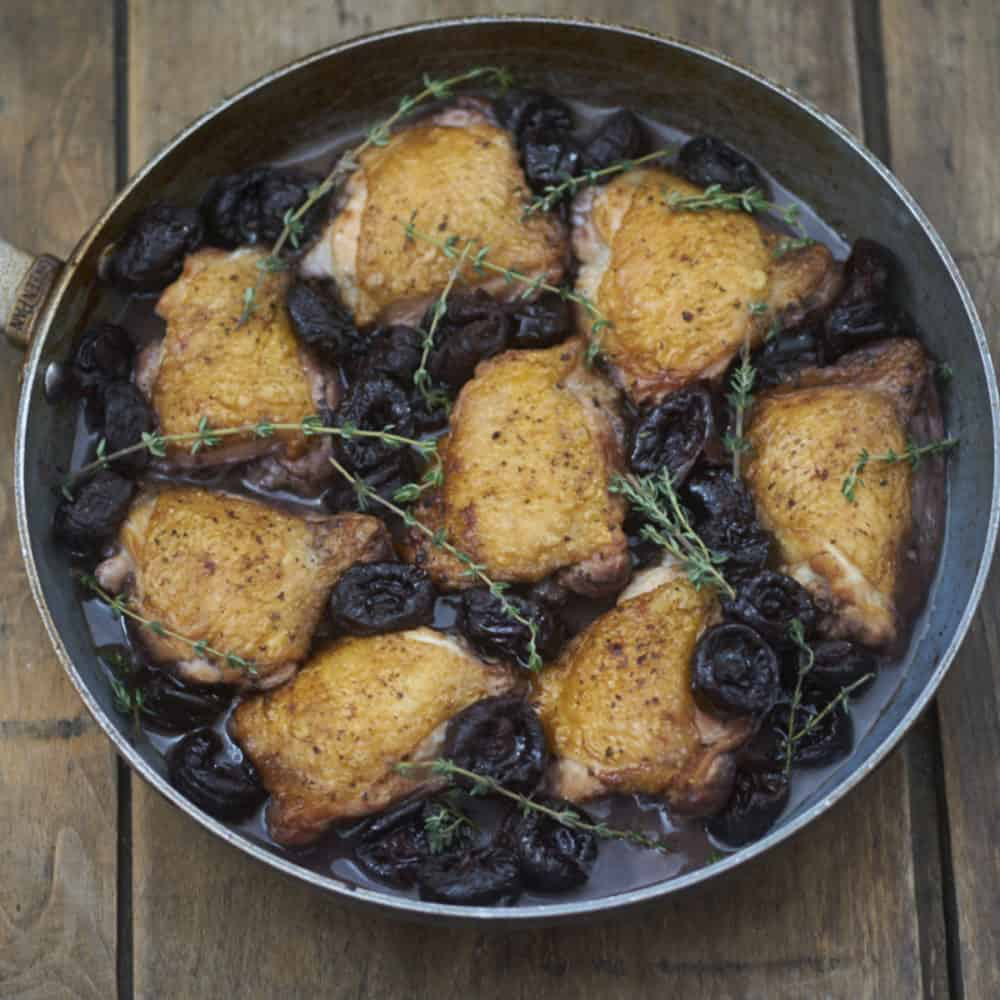 Chicken thighs in red wine with dried plums