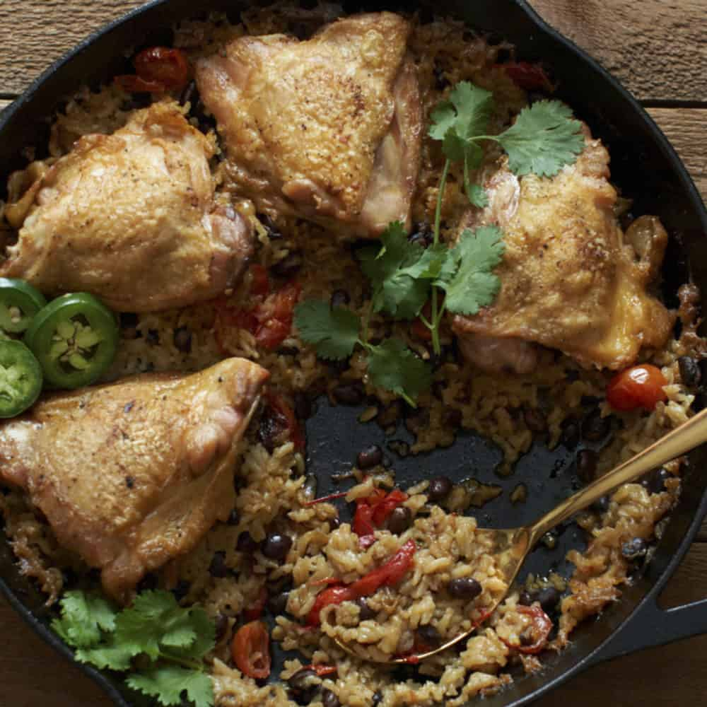 Chicken thighs with rice and black beans