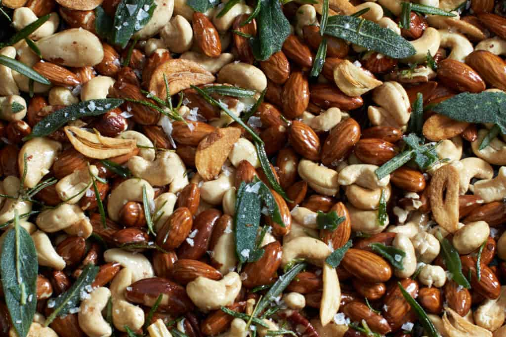 oven roasted nuts with rosemary, sage, and crispy garlic