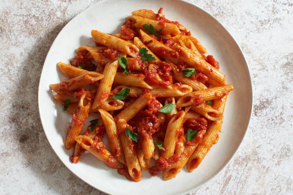 penne all'arrabbiata on a white plate