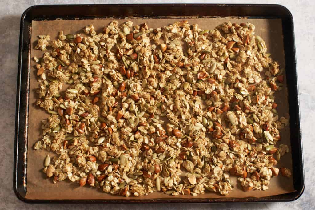 Granola on a sheet pan ready to be baked.