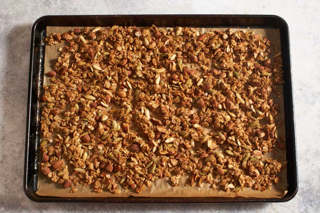Finished homemade granola on a sheet pan.