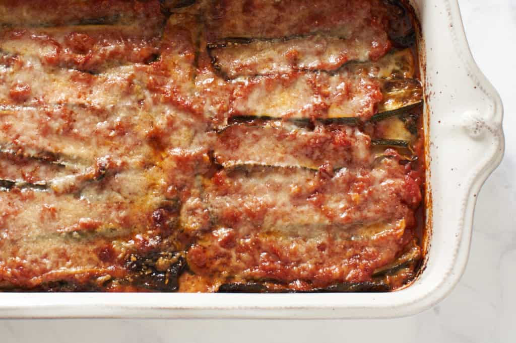 A casserole dish of baked zucchini parmesan.