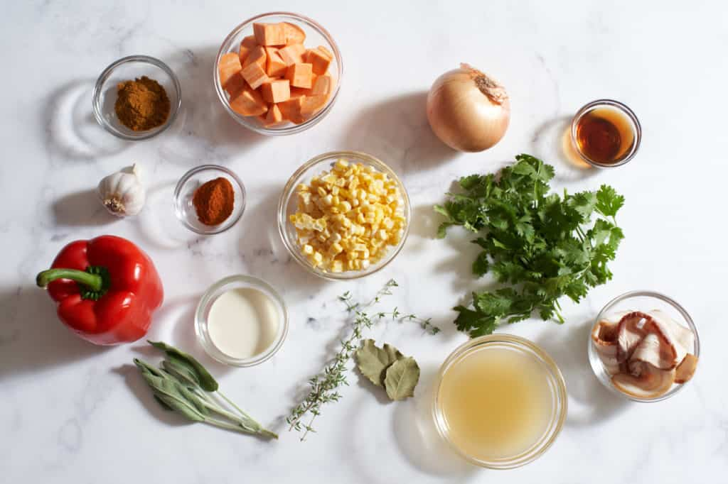 Small bowls of ingredients, fresh vegetables and fresh herbs.