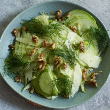 Fennel apple salad on a gray plate.