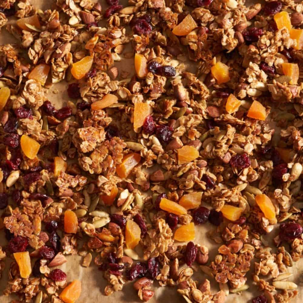 Homemade granola on parchment paper.